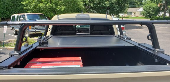 Rack Attack Minneapolis had a customer with a 2018 Tacoma they were looking to outfit for a roof top tent so their truck would be adventurous as they are. While they are still undecided on the tent they want, we got them dialed in with a super awesome Retrax Tonneau cover and the new Yakima Outpost