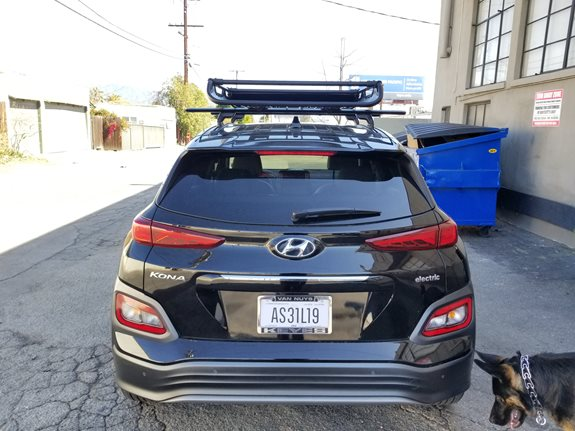 Custom tracks with Yakima Jetstream bars, and offgrid roof basket! No roof rack fit? No problem