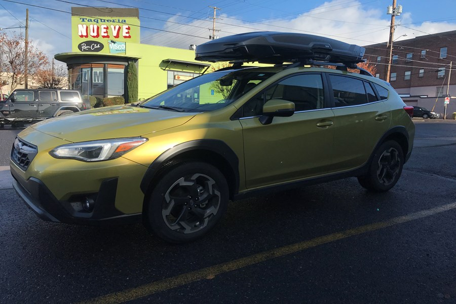 This Crosstrek is outfitted with Thule Wingbars and a Vector Alpine cargo box