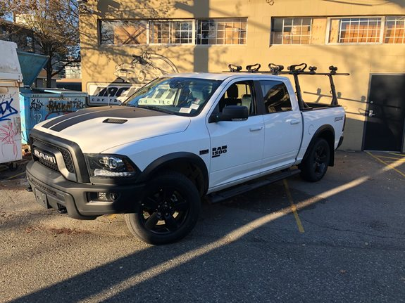 An awesome setup on a Ram Warlock with the Yakima Overhaul and some kayak racks!