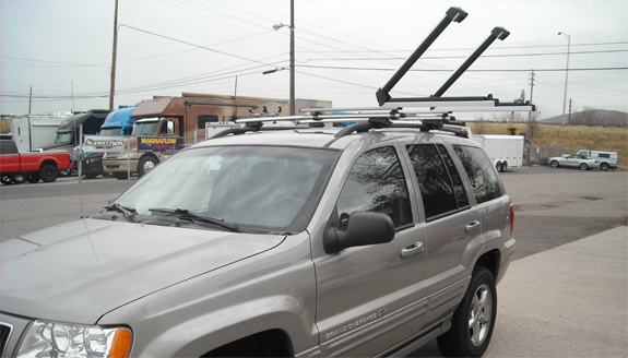 This is a custom 2003 Jeep Grand Cherokee ski & snowboard roof rack system