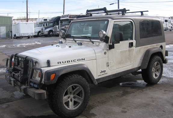 This is a custom 2006 Jeep Wrangler Rubicon Unlimited 2dr ski & snowboard roof rack system