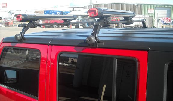 This is a custom 2008 Jeep Wrangler Unlimited 4dr ski & snowboard roof rack system