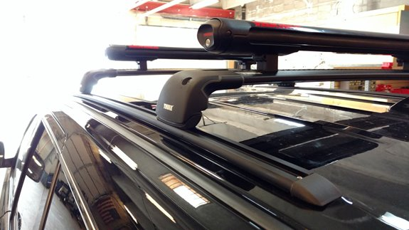 This is a custom base rack on a 2013 Jeep Grand Cherokee Altitude edition with a Yakima Fat Cat ski carrier.