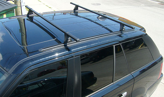 2008 Land Rover Range Rover Sport base roof rack, Thule TP54 54 Inch Top Track with Flare-Nuts, Thule TK1 Tracker Kit 1, Thule 430 Tracker II Foot Pack, Thule LB50 50 Inch Load Bars, Thule 544 4-pack Lock Cores