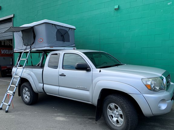 Tepui Hybox Tent mounted on Yakima's Overhaul HD and Aluminum Retrax Tonneau installed on this 2010 Toyota Tacoma is the perfect setup for outdoor adventures!