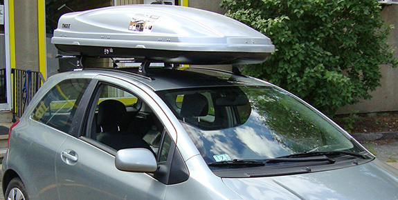 2007 Toyota Yaris 3dr cargo box/cargo carrier roof rack, Thule TP42 42 Inch Top-Track with Flare-Nuts, Thule TK1 Tracker Kit 1, Thule 430 Tracker II Foot Pack, Thule LB58 58 Inch Load Bars, Thule 544 4-pack Lock Cores, Thule 687XT Atlantis 1800 Silver