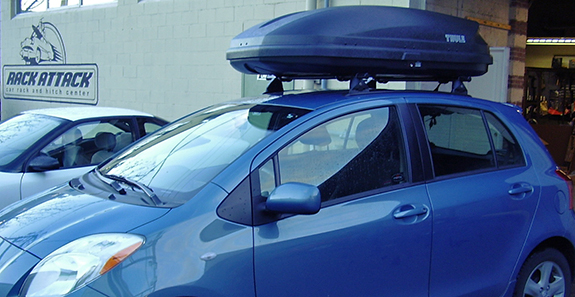 2009 Toyota Yaris 5dr cargo box/cargo carrier roof rack, Yakima 42 Inch Track with Plusnuts, Yakima Landing Pad 1, Yakima Control Towers, Yakima 48 Inch Cross Bars, Yakima 4 Pack SKS Cores, Thule 603 Ascent