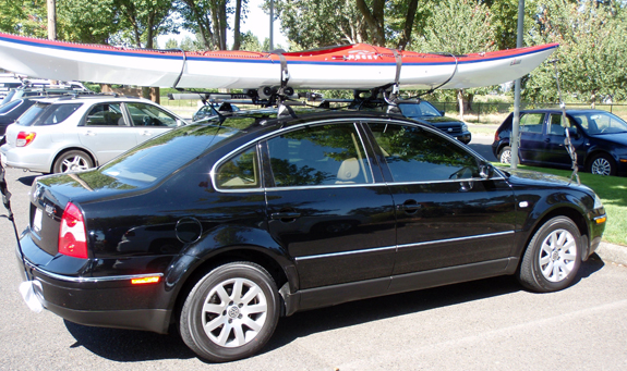 2002 Volkswagen Passat bike & kayak roof rack, Yakima 42 Inch Track with Plusnuts, Yakima Landing Pad 1, Yakima Control Towers, Yakima 48 Inch Cross Bars, Yakima Mako Saddles with Tie Down, Yakima HullyRollers with Tie Down, Yakima Accessory Lock Housing, Yakima 4 Pack SKS Cores, Thule 518 Echelon